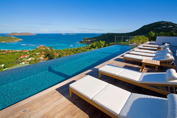 Lounge pool side and enjoy views of St. Jean Bay
