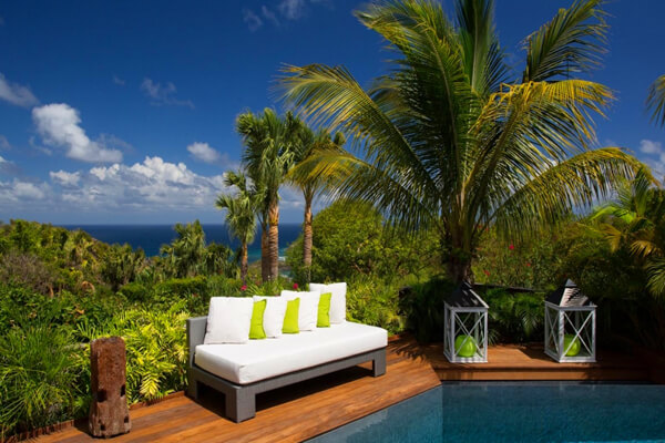 Enjoy views of Marigot Bay in the distance from the pool deck at Carmen Villa