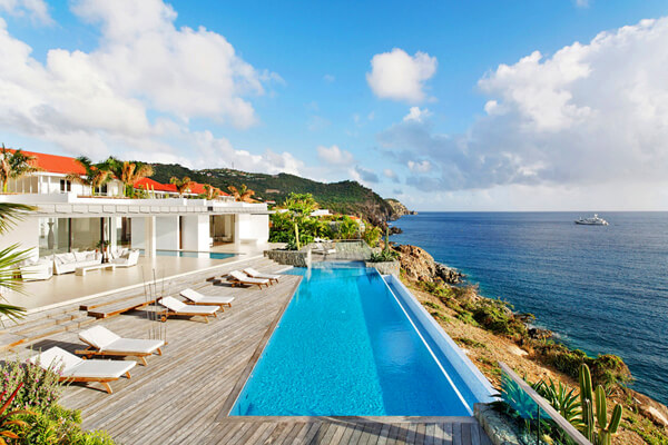 The large pool at Roxanne villa overlooks the Caribbean