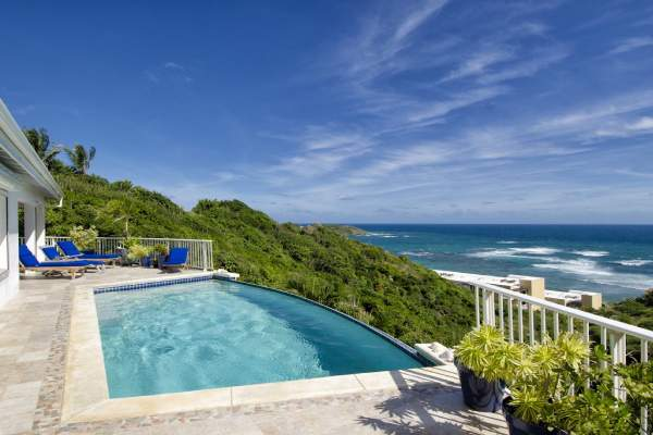 Beautiful views of the Caribbean form the pool at Dawn Beach Villa