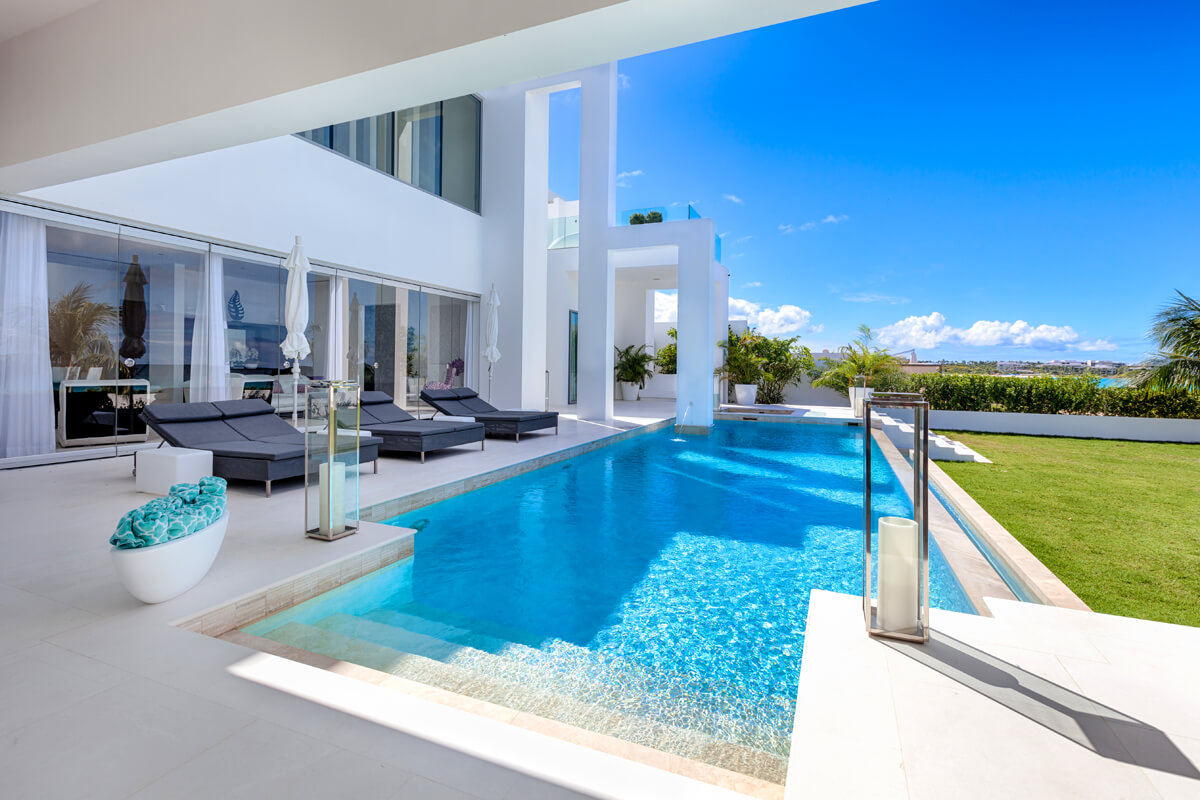The Beach House Features An Amazing Pool And Outdoor Area