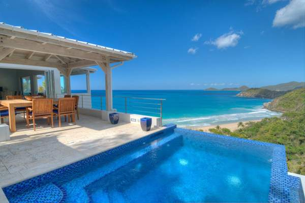 Infinity edge pool with amazing views of Trunk Bay Beach at Soleil villa