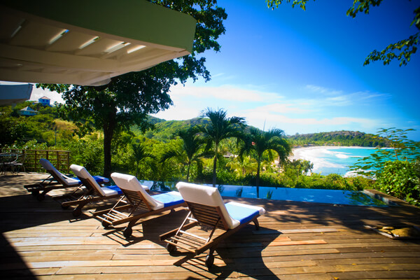 Relax on the deck at Red Sun Villa and enjoy great views of Landing Bay