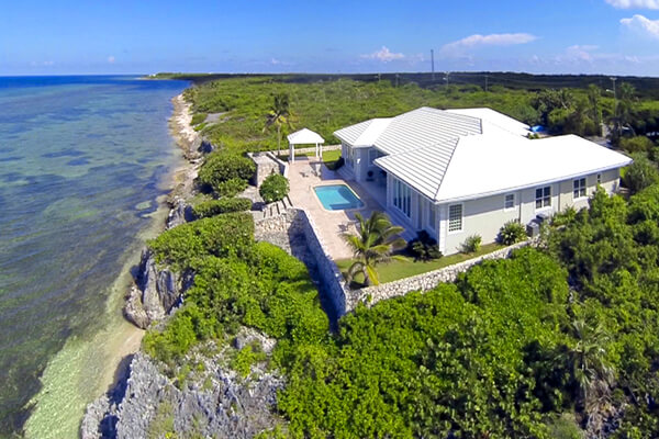 The beautiful Crystal Blue Villa is perched on a cliffside just off Queens Highway