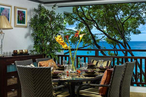 Sit on the patio at Coral Cove 12 and enjoy beautiful views of the Caribbean