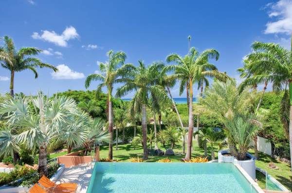 Blue Palm Villa is surrounded by lush tropical greenery