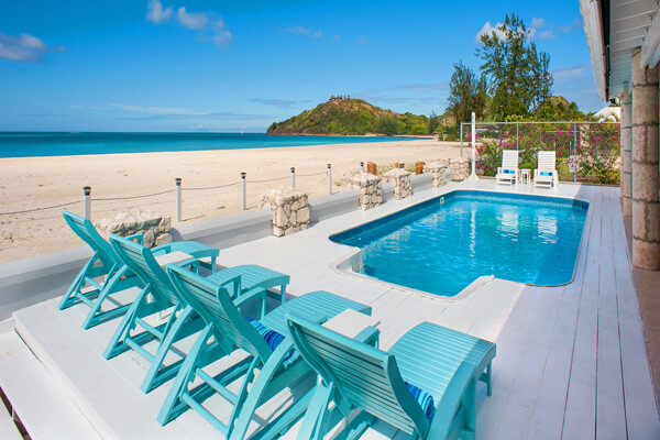 Lounge by the beachside pool at Island View Beach House