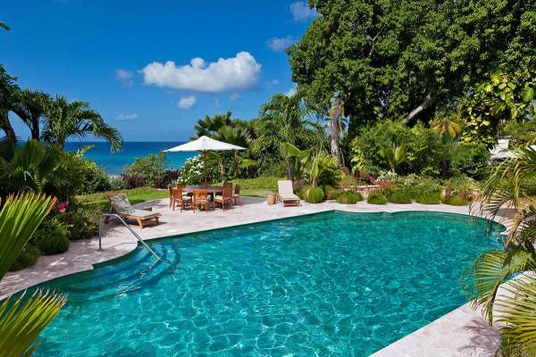 Tropical luxury surrounds the pool area and views of the ocean at Gardenia Villa