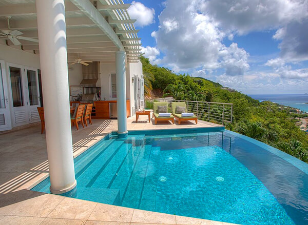 The infinity edge pool at Palms at Morningstar villa offers amazing ocean views