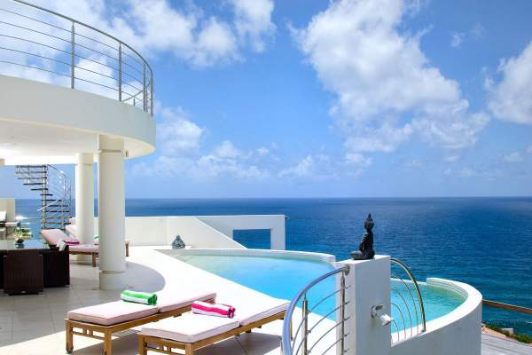 Relax by the pool and enjoy the ocean view at Sky Blue