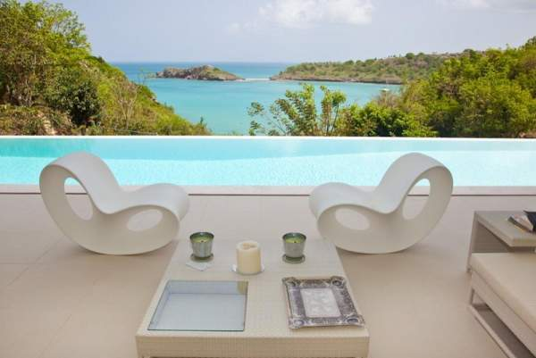 Relax in style by the poolside over looking the Caribbean
