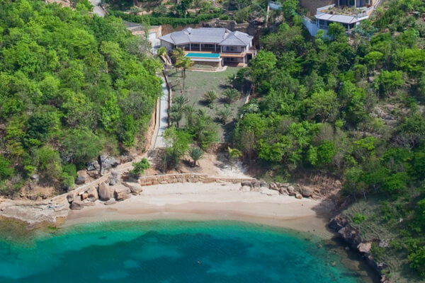 Aerial view of Galley Bay Heights Villa #104 and the beautiful beachfront