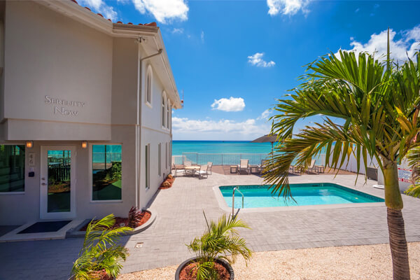 Serenity Now Villa is located in the West Bay area and is steps away from Seven Mile Beach