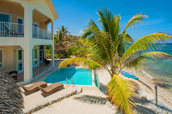 A beachfront pool awaits you at Christmas Palms Villa