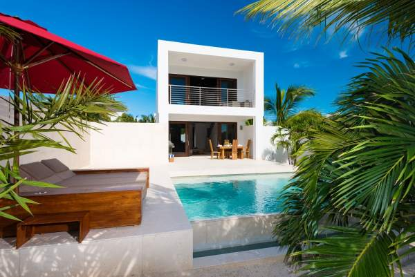 Sugar Cube Villa sits directly on Grace Bay Beach