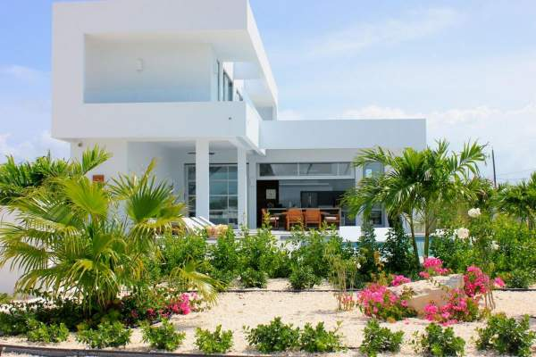 White Villa 1 will accomodate up to six guests and features lush tropical landscaping