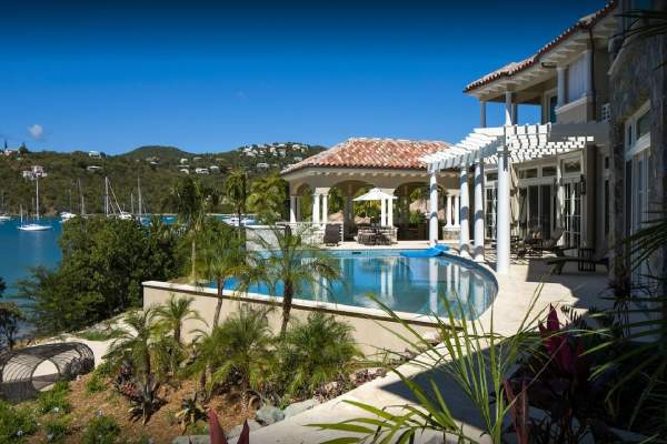 Pool and backyard facing Great Cruz Bay at Ardisia Villa